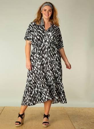 Długa, zwiewna, naturalna suknia z falbaną